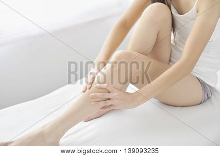 Soft Care for female sexy legs isolated on white background