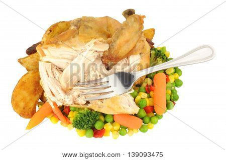 Roast chicken portion meal with vegetables isolated on a white background