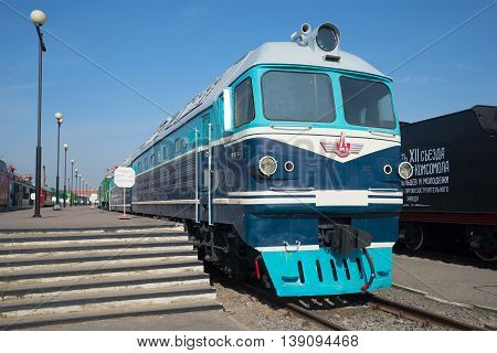 SAINT PETERSBURG, RUSSIA - MARCH 30, 2016: Vintage passenger diesel locomotive TG-102 at the platform at Oktyabrskaya railway, Historical landmark of the Saint-Petersburg