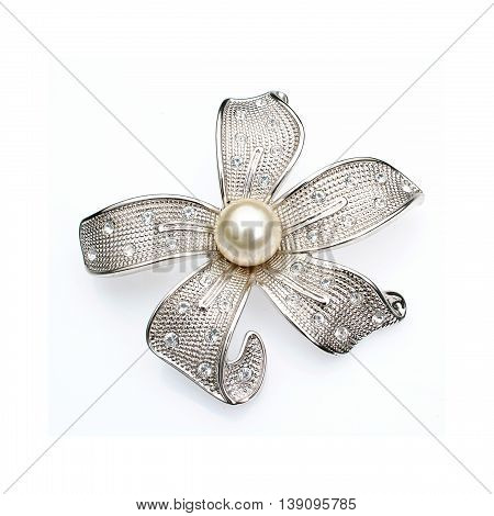 Silver adornment with pearl in white background