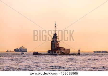 Maiden's Tower at sunset in Istanbul. Travel Turkey. View from the water. Kiz Kulesi. The tower on a small island in the Bosporus Strait.