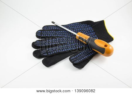 Screwdriver and work gloves on a white background