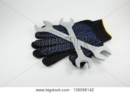 Wrenches work gloves on a white background