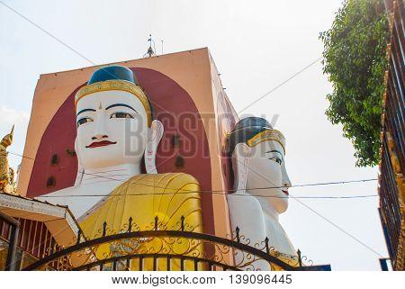 Four Statues Of Sitting Buddhas. Pagoda Kyaikpun Buddha. Bago, Myanmar. Burma.