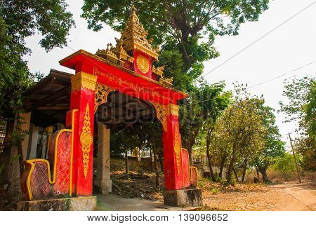 The Entrance To The Temple. Pagoda Kyaikpun Buddha. Bago, Myanmar. Burma.