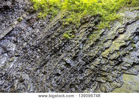 Layers of rocks under the influence of long-term water. Background