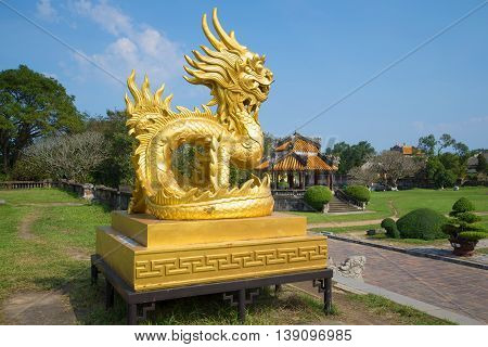 HUE, VIETNAM - JANUARY 07, 2016: Golden Dragon Sculpture on the terrace of the Imperial Forbidden Purple City. Historical landmark of the city Hue, Vietnam