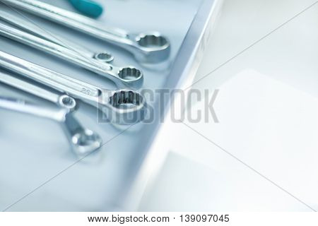 Composition of wrenches on table, cloce up