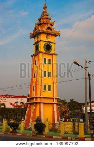The high clock tower on the street. Bago in Myanmar. Burma.