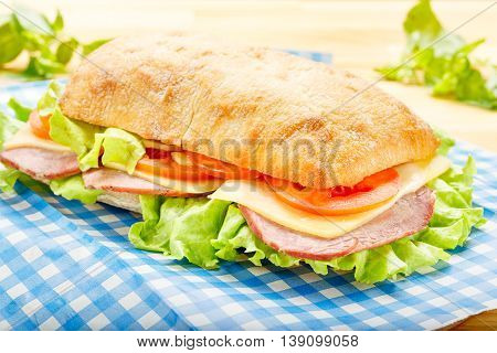 Big Ciabatta Sandwich with Bacon Lettuce Tomato Cheese and Sauces