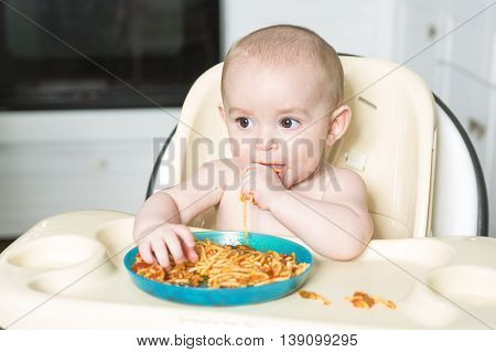 A Little b eating her dinner and making a mess