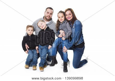 An attractive portrait of young happy family over white background