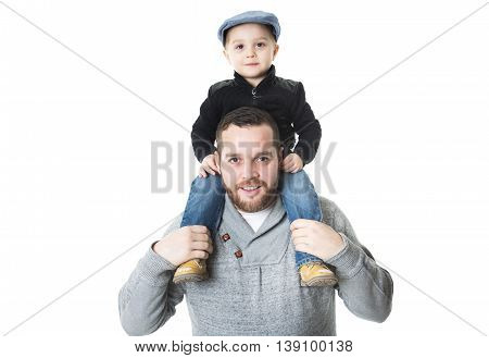 A Father carrying his son on shoulders - isolated over a white background