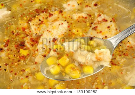 Spoon with chicken and sweetcorn soup