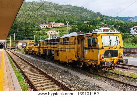 Monterosso Italy - July 02 2016: antique train at the rail station in Monterosso al Mare. The national railway network state-owned and operated by Ferrovie dello Stato in 2008 totalled 16529 km