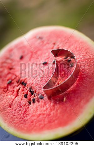 Juicy cut half of delicious watermelon and a cookie cutter. Summer fruit.Sunny day