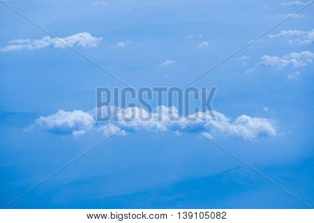 A blue sky background with white clouds.