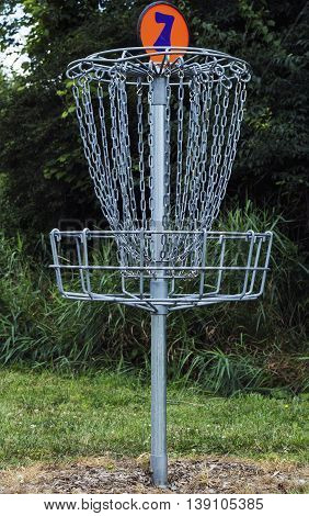 Golf basket number 7 on a course
