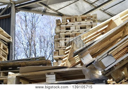 Waste wood from pallets stacked in the storage room.