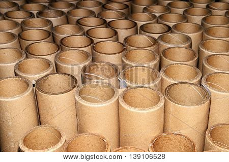 Manufacturing background in the form of cardboard tubes.