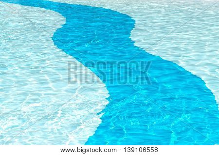 clear crystal cool swimming pool background with sun reflection ripples in a two tone blue solid curve patten ideal for ad poster copy space or text