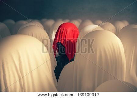 Uniqueness and leadership concept with abstract human head under red piece of cloth on concrete background. 3D Rendering