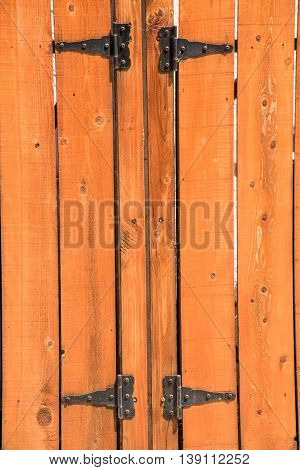 knotted wooden picket fence and gate and hinges