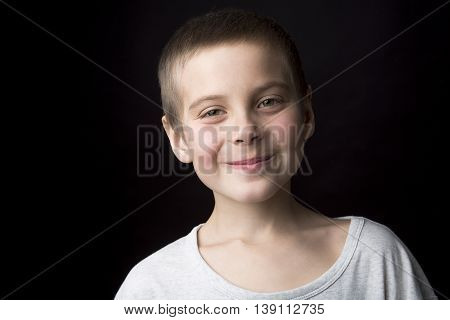 A Portrait smiling boy of eight years.