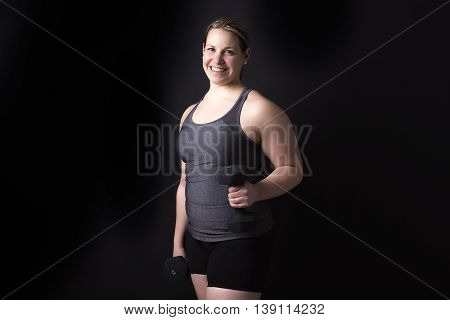 A Beautiful woman exercising in studio background