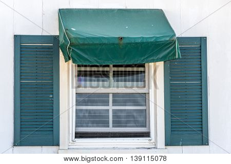 sash window with hunter green simple awing tent and shutters