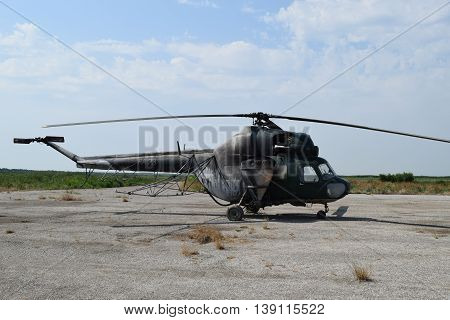 Old Helicopter Spraying Fields