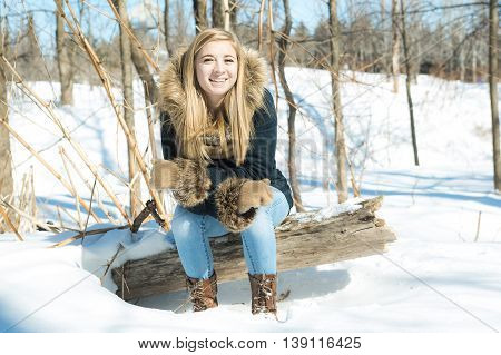An Attractive young woman in wintertime outdoor