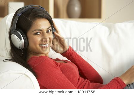 Young Woman Listening To Music At Home