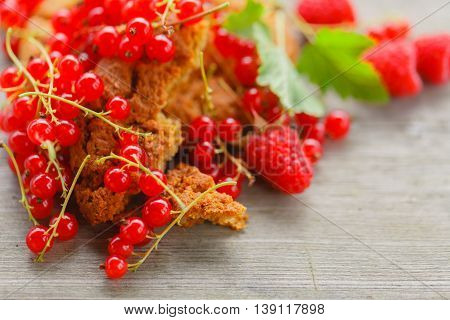 Oat Cookiea And Different Berries On Old Wooden Table