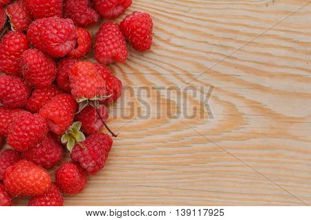 Raspberries On Wooden Background. Close Up, Top View, High Resolution Product. Harvest Concept
