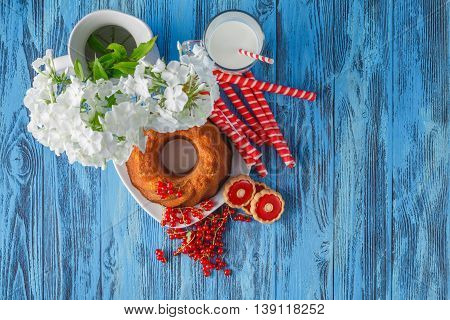 Ring Cake With Raisins, Berries, Mug On Wooden Table