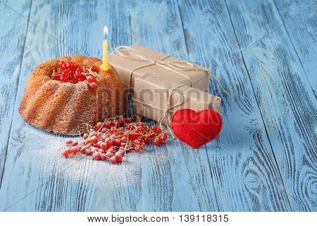 Cake With Currant On Wooden Background