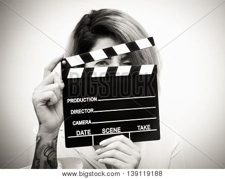 Young Blonde Woman With Movie Clapper Portrait