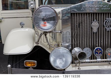 Manchester United Kingdom - 12 June 2016: Antique Imperial Landaulette car front close-up. The car is often being used as a wedding vehicle.