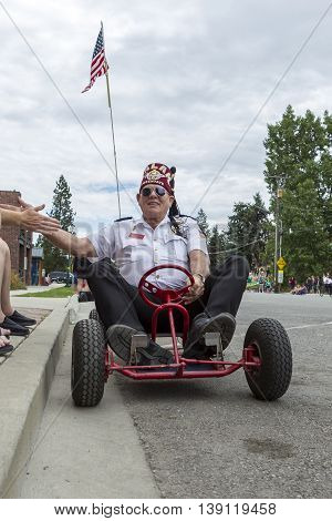 Rathdrum Idaho USA - July 16 2016. A member of Katif drives a go kart in the Rathdrum Days parade on July 16 2016.