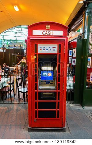 Historic Red Phone Box Used As A Cash Machine In London, Uk