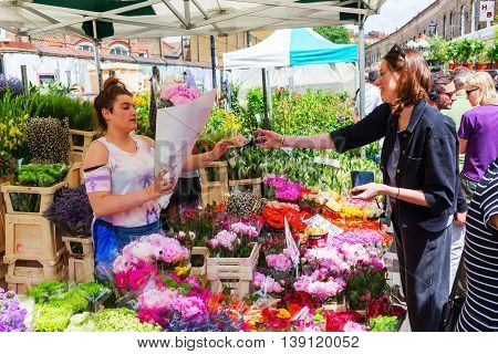 London UK - June 19 2016: Columbia Road Flower Market with unidentified people. It is a popular historic street market in the London Borough of Tower Hamlets.