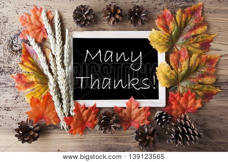 Blackboard With Autumn Or Fall Decoration. Greeting Card For Seasons Greetings. Colorful Leaves, Fir Cone And Barley On Aged Wooden Background. English Text Many Thanks