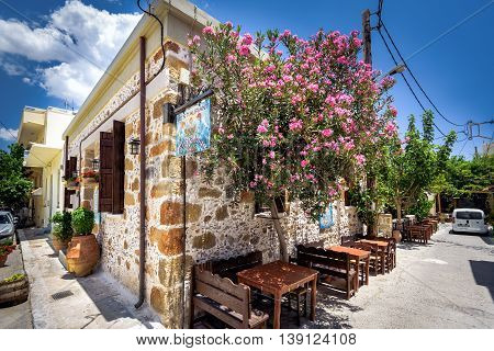 PALEOCHORA, CRETE, GREECE - June 29, 2016: Traditional Greek restaurant, located in traditional Greek house on Crete island.