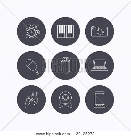 Photo camera, USB flash and notebook laptop icons. PC mouse, alarm clock and web camera linear signs. Tablet PC and music headphones icons. Flat icons in circle buttons on white background. Vector