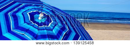 Blue striped beach umbrella at Newcombs Hollow, Wellfleet Massachusetts on Cape Cod-Proportionate to Large Mobile Banner