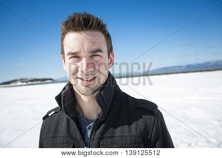A Handsome young man in winter nature
