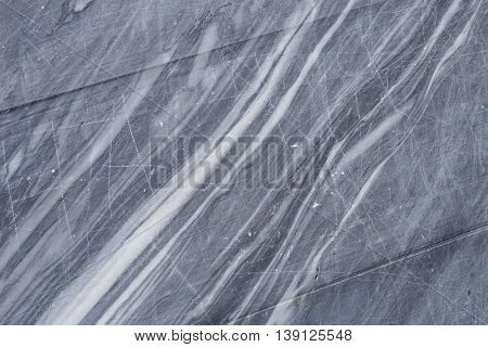 Texture of the raw cut smooth surface of white and grey marble. Background white marble stone in its natural form. Stone material for making buildings and interior. Industrial materials marble.