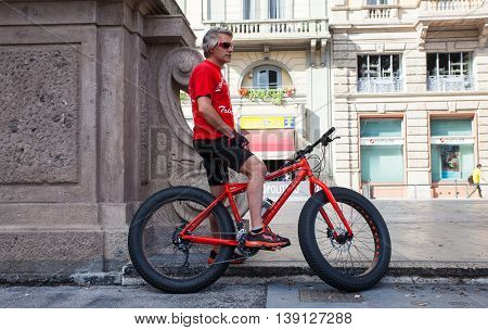 MILAN ITALY - JUNE 04: Biker in red waiting in the street on June 04 2016