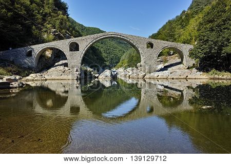 Amazing Reflection of The Devil's Bridge in Arda river and Rhodopes mountain, Kardzhali Region, Bulgaria